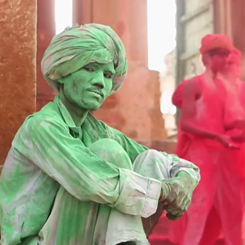 Indian man covered in green coloring